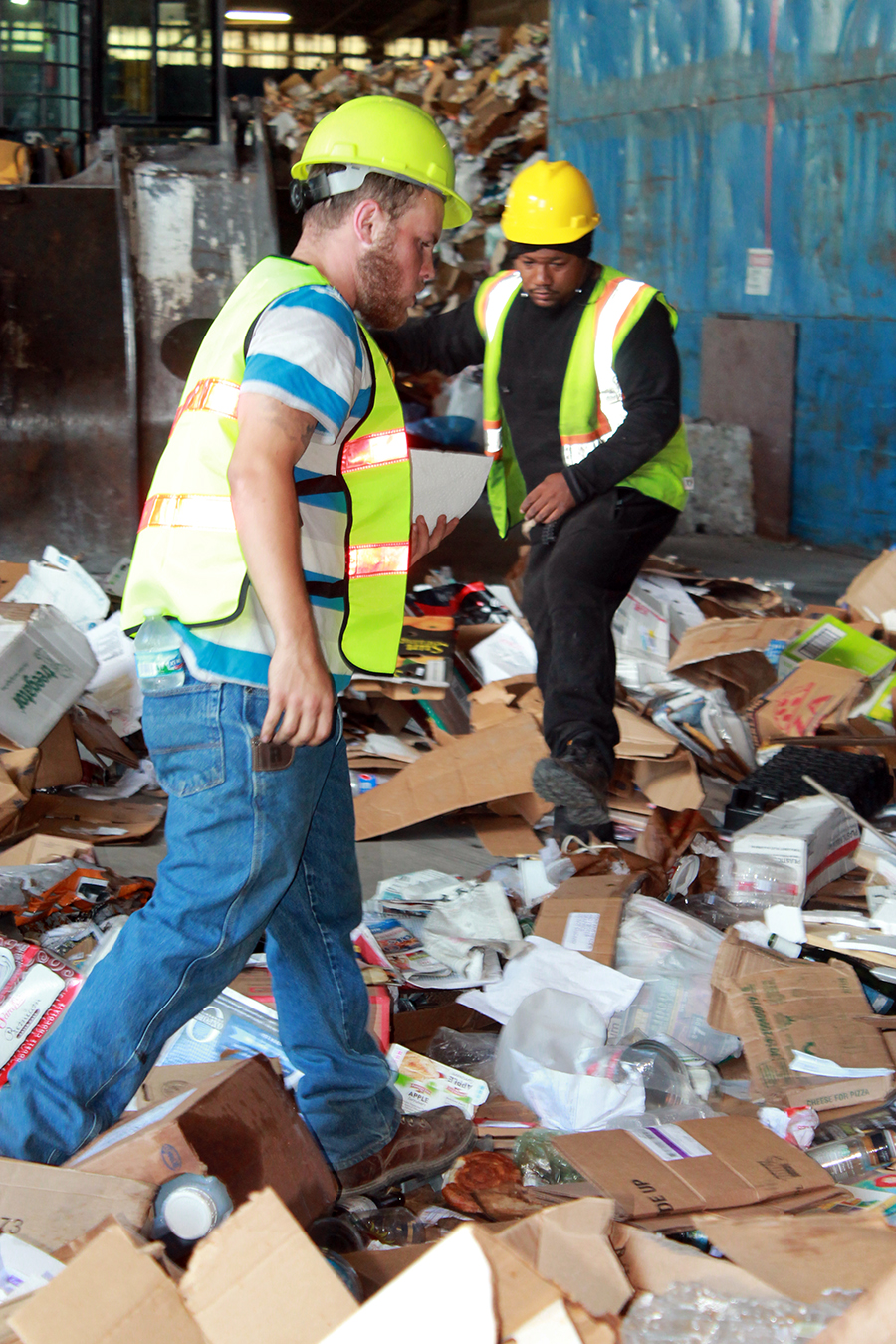 Seth and OJ Sorting Recyclables